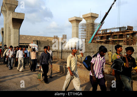 Pedestrian from construction site of bridge ; Bombay Mumbai ; Maharashtra ; India - Stock Photo