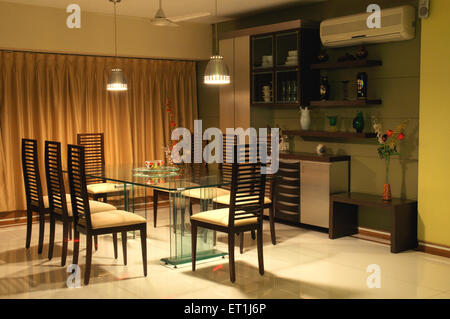 Dining table chairs in living room of Indian home in Bombay Mumbai Maharashtra India - PR#191 - ssk 166012 - Stock Photo