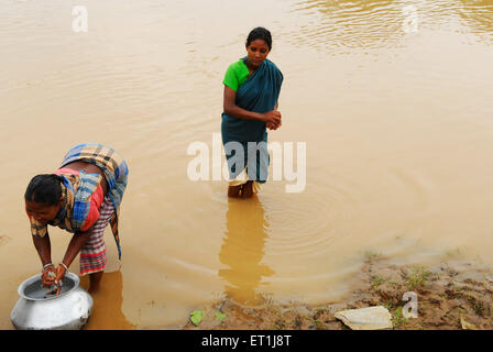 Ho tribes women washing clothes in river ; Chakradharpur ; Jharkhand ; India NO MR - Stock Photo