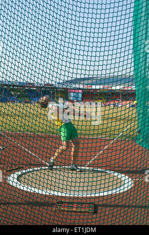 Athlete attempting hammer throw in third commonwealth youth games ; Pune ; Maharashtra India - Stock Photo