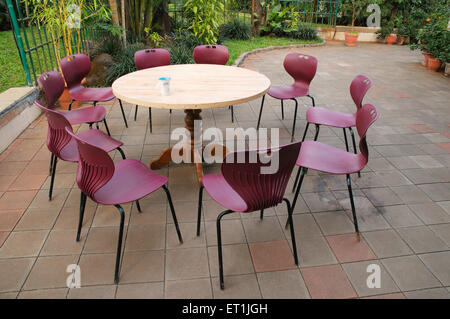 Plastic chairs kept around wooden table with mug 18 January 2009 - Stock Photo
