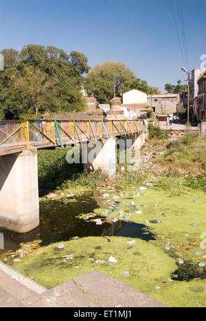 Pollution ; river turns into garbage dump ; people throw rubbish in river karh at Sasvad village ; taluka Purandar - Stock Photo