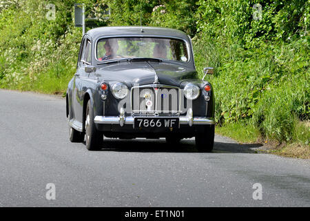 1960s Rover 100 classic saloon car on country road, Burnfoot, County Donegal, Ireland - Stock Photo