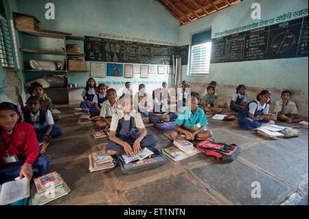 Girls and boys learning in classroom at Rajwadi ; Sangmeshwar ; Ratnagiri ; Maharashtra  ; India - Stock Photo