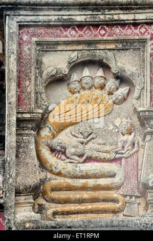 Vishnu resting on Shesha naga relief sculpture on bhuleshwar temple at yawat pune Maharashtra India Asia - Stock Photo