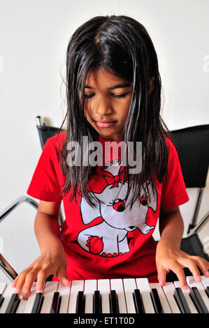 Maharashtrian girl playing synthesizer MR#556 - Stock Photo
