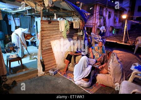 Mourners and relatives gather house of Harish Gohil killed in attack Nariman House bomb blasts on 26th November - Stock Photo