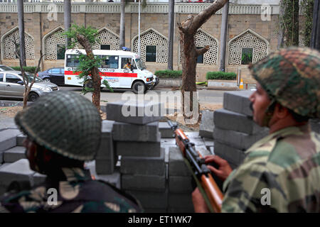 Soldiers on guard outside Taj Mahal hotel during attack by Deccan Mujahideen on 26th November 2008 Mumbai - Stock Photo