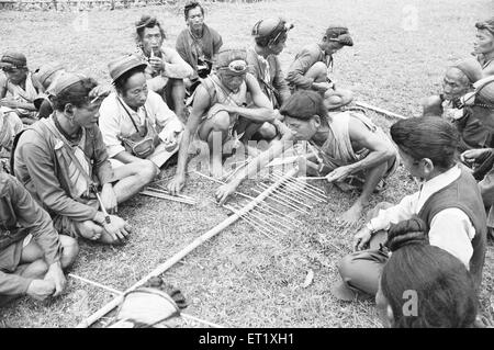 Village dispute between two groups of Bagni tribesmen of Kameng settled in presence of village headmen ; Arunachal - Stock Photo