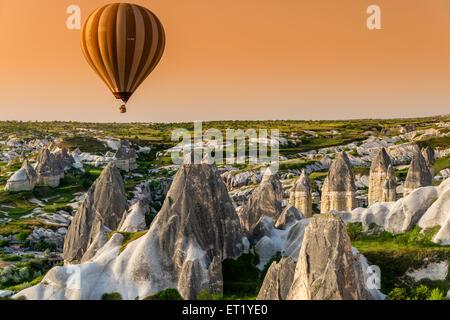 Sunrise landscape with hot air balloon, Goreme, Cappadocia, Turkey