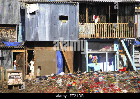 Debris at slum ; Behram Naupada ; Anant Kanekar Marg ; Bandra ; Bombay Mumbai ; Maharashtra ; India 17 September - Stock Photo