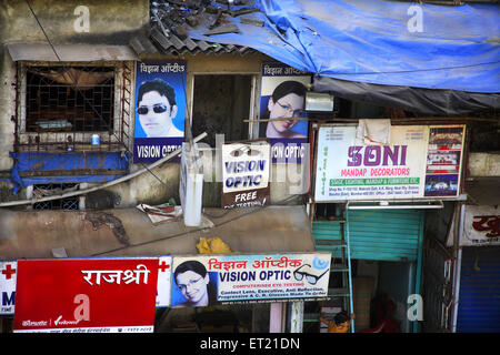 Optic shop in slum ; Behram Naupada ; Anant Kanekar Marg ; Bandra ; Bombay Mumbai ; Maharashtra ; India 17 September - Stock Photo