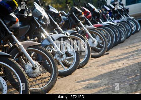 Bike motorcycles parking ; Bombay Mumbai ; Maharashtra ; India 29 January 2010 - Stock Photo