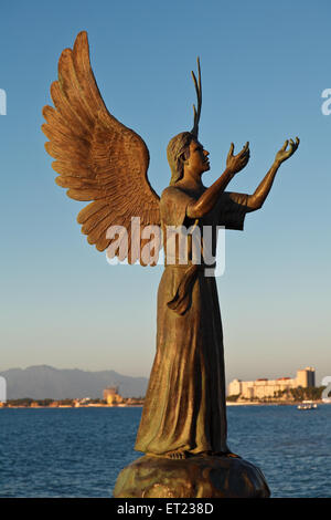 Angel of Hope and Messenger of Peace on El Malecon, Puerto Vallarta, Mexico - Stock Photo