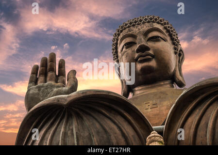 The enormous Tian Tan Buddha at Po Lin Monastery in Hong Kong. - Stock Photo
