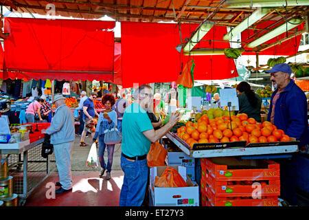 TEL AVIV, ISR - MAR 27 2015:Shoppers at Carmel Market Shuk HaCarmel in Tel Aviv, Israel.It's a very popular marketplace - Stock Photo