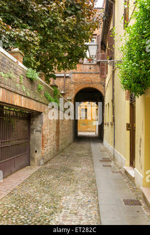 Small ancient street in the old downtown of Ferrara, Italy - Stock Photo