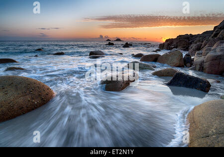 Sea worn boulders on the beach at Porth Nanven near Lands End in Cornwall - Stock Photo