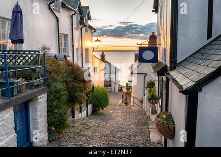 Narrow cobbled streets lined with cottages on a steep hill at Clovelly on the Devon coast - Stock Photo