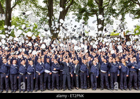 Cap throw after a swearing in ceremony of 1500 new police officers in Dortmund, Germany - Stock Photo