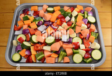 Chopped raw vegetables - red onion, butternut squash, red pepper, courgette, parsnip, green pepper, sweet potato - Stock Photo
