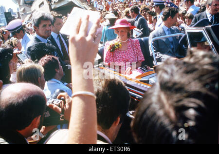 The Prince and Princess of Wales in a car driving through crowds of well wishers in front of Sydney Opera House, - Stock Photo