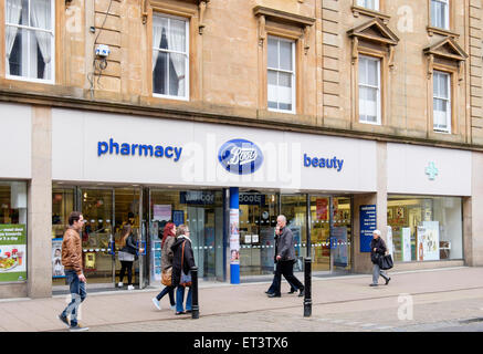 Boots pharmacy chemist store shop front with shoppers passing outside on High Street, Ayr, Ayrshire, Scotland, UK, - Stock Photo