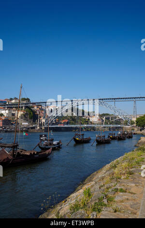 Wooden boats (Rabelos) moored on the river Douro by Cais de Gaia nearby the Ponte Luis I - Porto, Portugal - Stock Photo