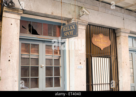Image of an old business in the French Quarter in New Orleans Louisiana - Stock Photo