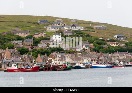 The town of Stromness on Orkney Mainland, seen from the sea. - Stock Photo