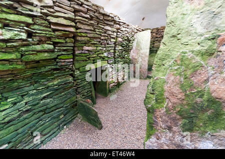 The interior of the chambered tomb of Unstan on Orkney Mainland. - Stock Photo