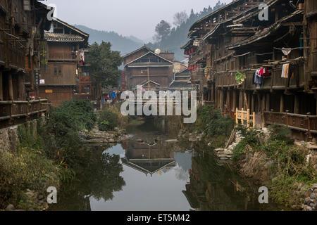 Dong village scene by the Nanjiang River, Zhaoxing Dong Village, Guizhou Province, China - Stock Photo