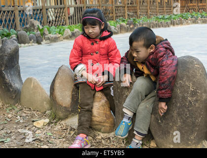 Dong children at play, Zhaoxing Dong Village, Guizhou Province, China - Stock Photo