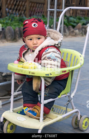 Toddler at Zhaoxing Dong Village, Guizhou Province, China - Stock Photo