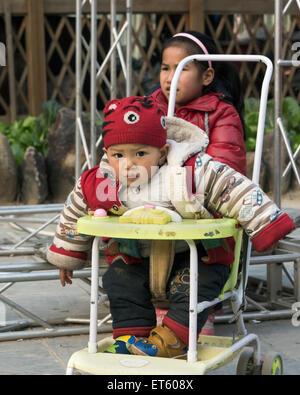 Young Dong boy, Zhaoxing Dong Village, Guizhou Province, China - Stock Photo