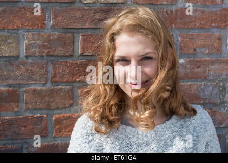 Close-up of Caucasian young woman smiling, Munich, Bavaria, Germany - Stock Photo