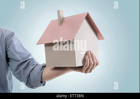 Real estate agent showing dream home, Bavaria, Germany - Stock Photo