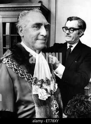 Councillor James Eames being robed by his attendant Mr. Tom Freer before being elected Lord Mayor of Birmingham. - Stock Photo