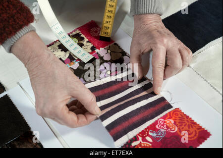 Senior female fashion designer working in workshop Bavaria Germany - Stock Photo