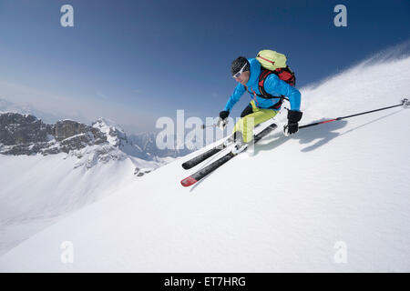 Young man skiing, Rofan, Tyrol, Austria - Stock Photo