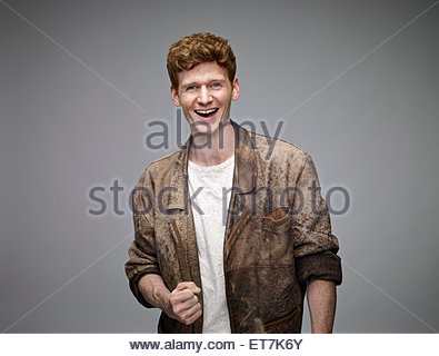 Portrait of laughing redheaded man - Stock Photo