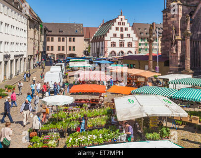 Germany, Freiburg im Breisgau, Minster Square, market stalls - Stock Photo