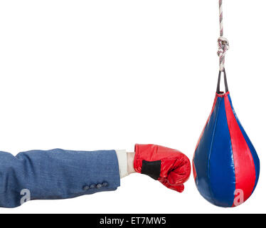 hand gesture - man in business suit with boxing glove punches punching bag isolated on white background - Stock Photo