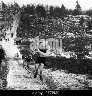 Bagshot Cyclist scramble on Bagshot Heath Surrey. 17th January 1960. - Stock Photo