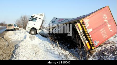A truck is seen overturned after a crash caused by a heavy snowfall at the highway near the Bulgarian town of Veliko - Stock Photo
