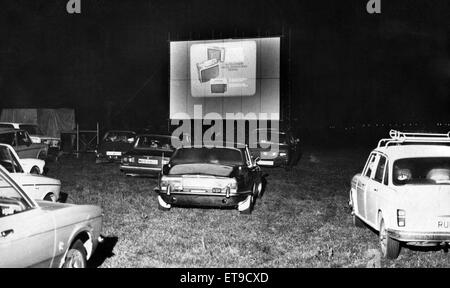 Drive In Cinema, in farmer Swinburne's cow pasture, with silos in the background, cattle mooing and, a bonus for - Stock Photo