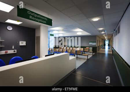 Hospital outpatients reception desk and waiting area without people - Stock Photo