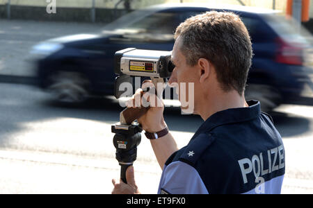 Berlin, Germany, a policeman at the speed control - Stock Photo