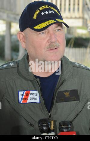U.S. Coast Guard Commandant Adm. Thad Allen answers questions during a press briefing at the Dauphin Island Pier - Stock Photo