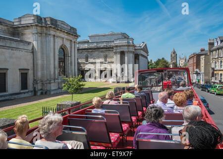 Tourists on open top city sightseeing bus near Fitzwilliam Museum, Trumpington Street, Cambridge, England UK - Stock Photo